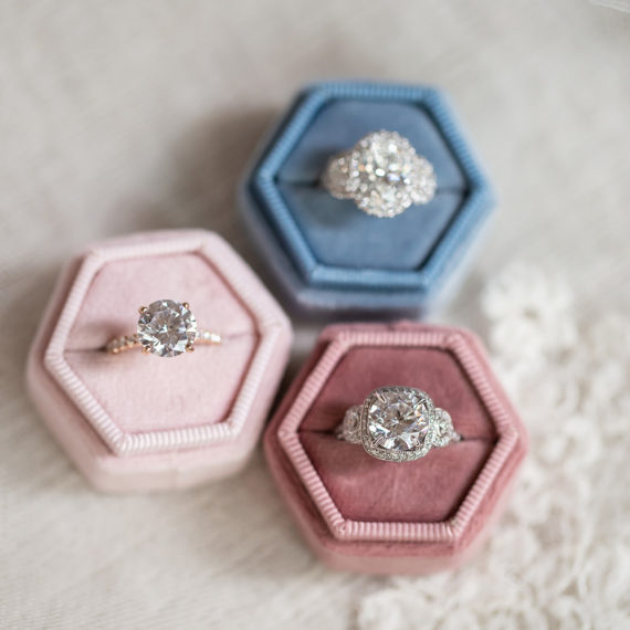Three rings in velvet ring boxes