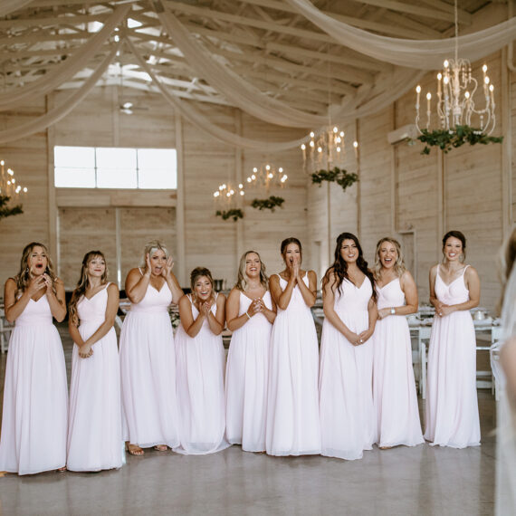 Bride's first look with bridesmaids